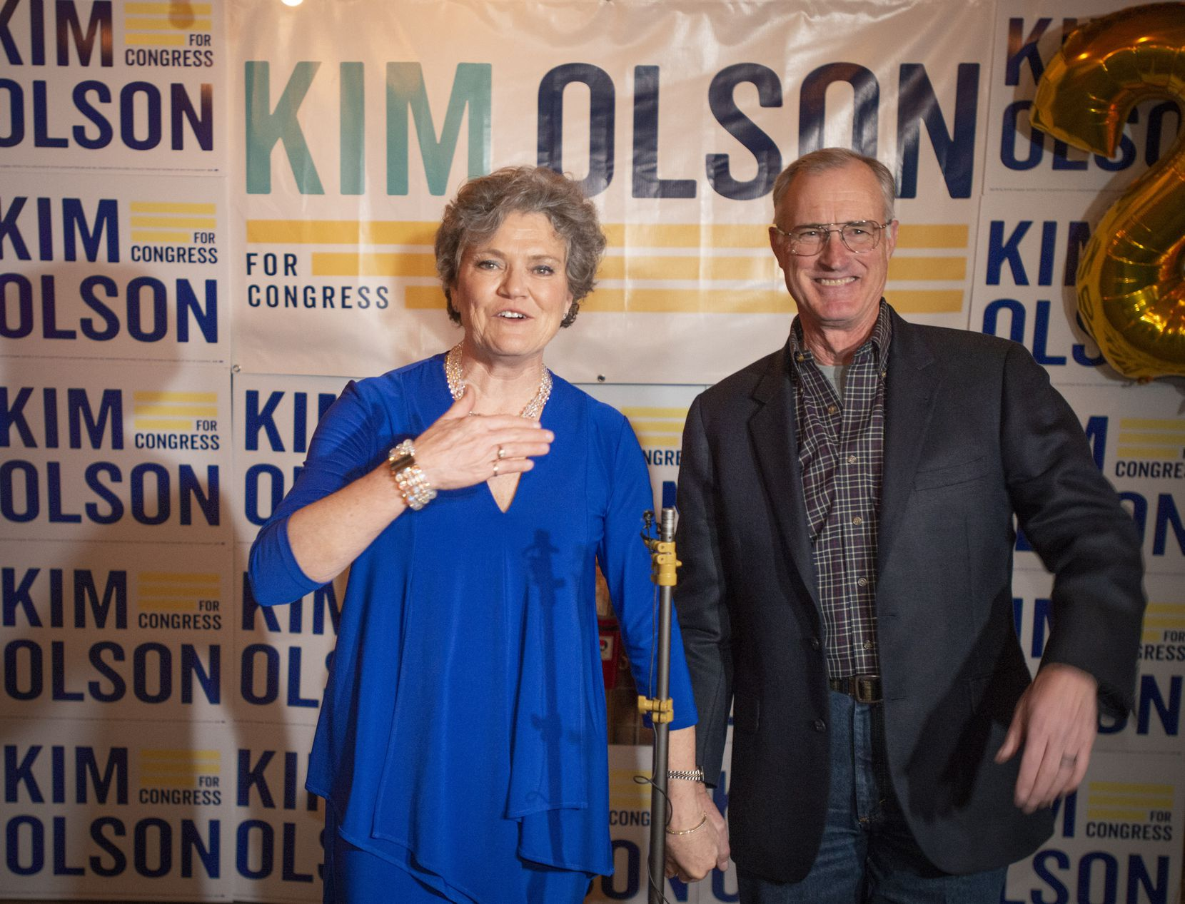 At her watch party at Boomer Jack's in Bedford, Texas Kim Olson with husband Kent Olson thanks her supporters and volunteers for their work on her campaign to be the Democratic candidate in Texas' 24th Congressional District . (Robert W. Hart/Special Contributor)