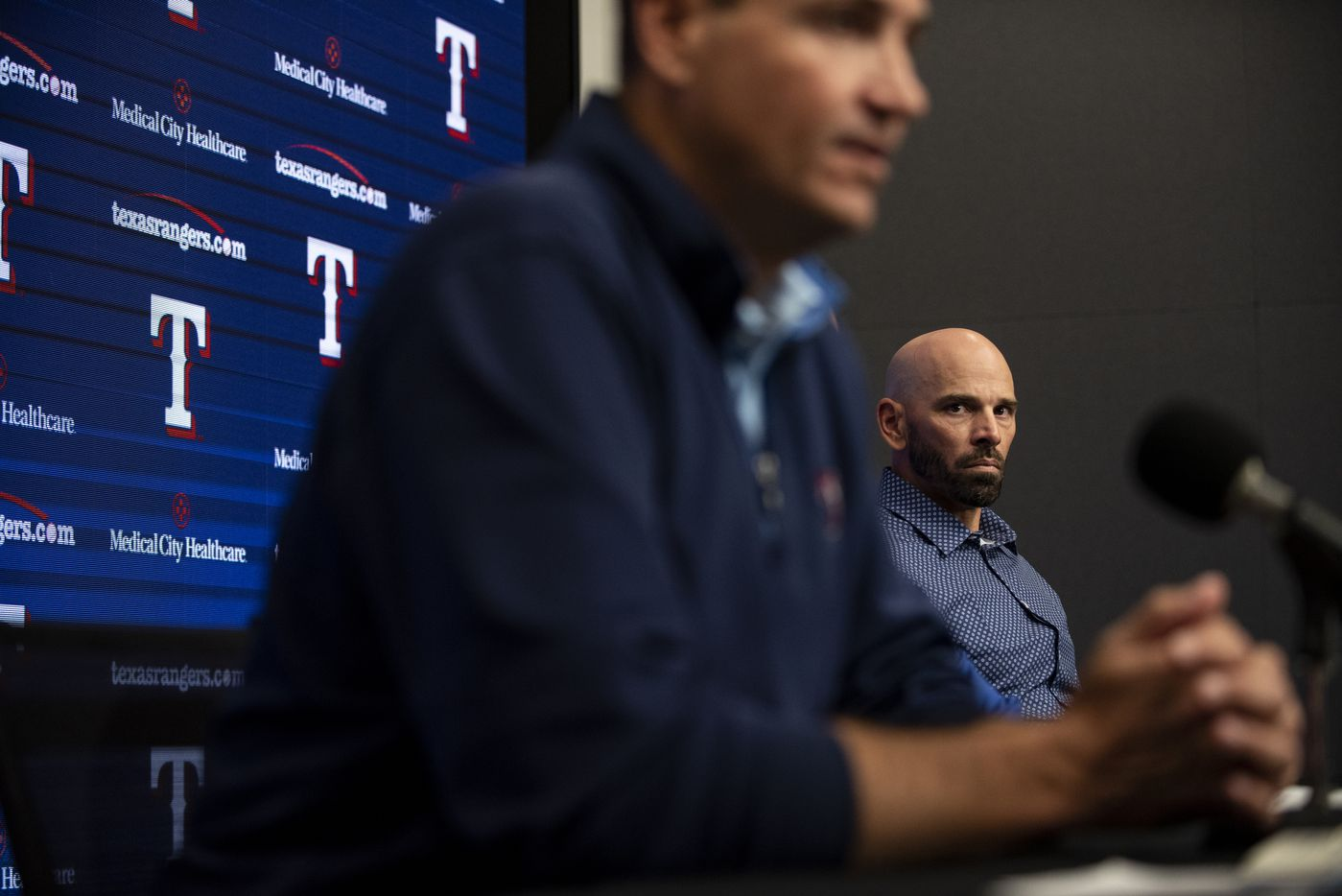 Texas Rangers Manager Chris Woodward listens to Executive Vice President and General Manager Chris Young answer a question during the Texas RangersÕ end of the year press conference at Globe Life Field on Wednesday, October 6, 2021 in Arlington, Texas. (Emil Lippe/Special Contributor)