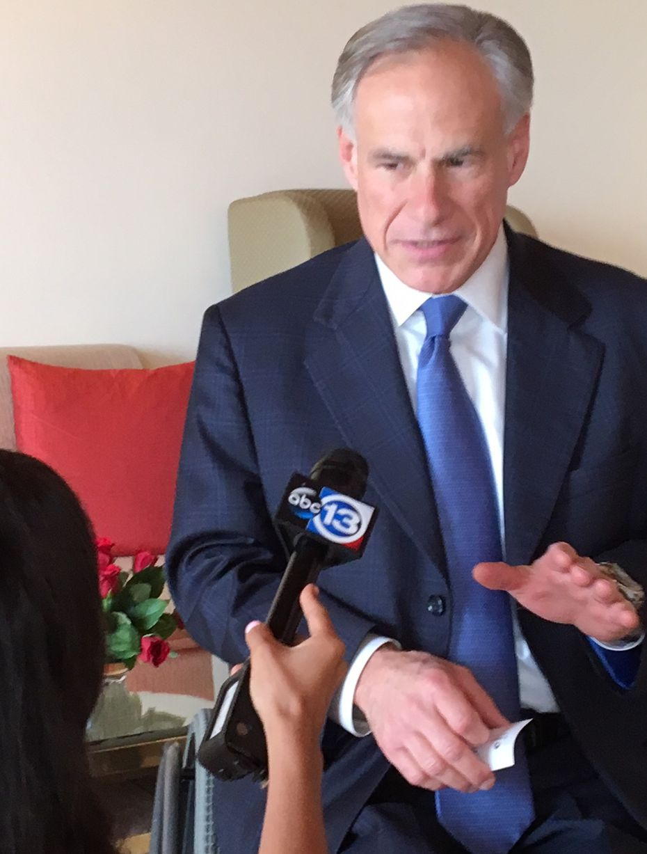 Gov. Greg Abbott debriefs TV pool reporter Pooja Lodhia of Houston's KTRK-TV about his Saturday meeting in Mumbai, India, with executives Reliance Industries Ltd.