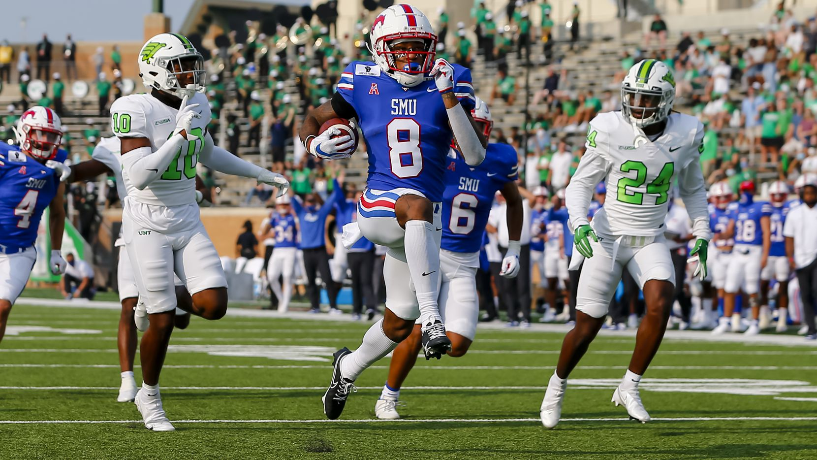 SMU wide receiver Reggie Roberson Jr. (8) scores a touchdown during a game against North Texas on Saturday, Sept. 19, 2020, at Apogee Stadium in Denton.