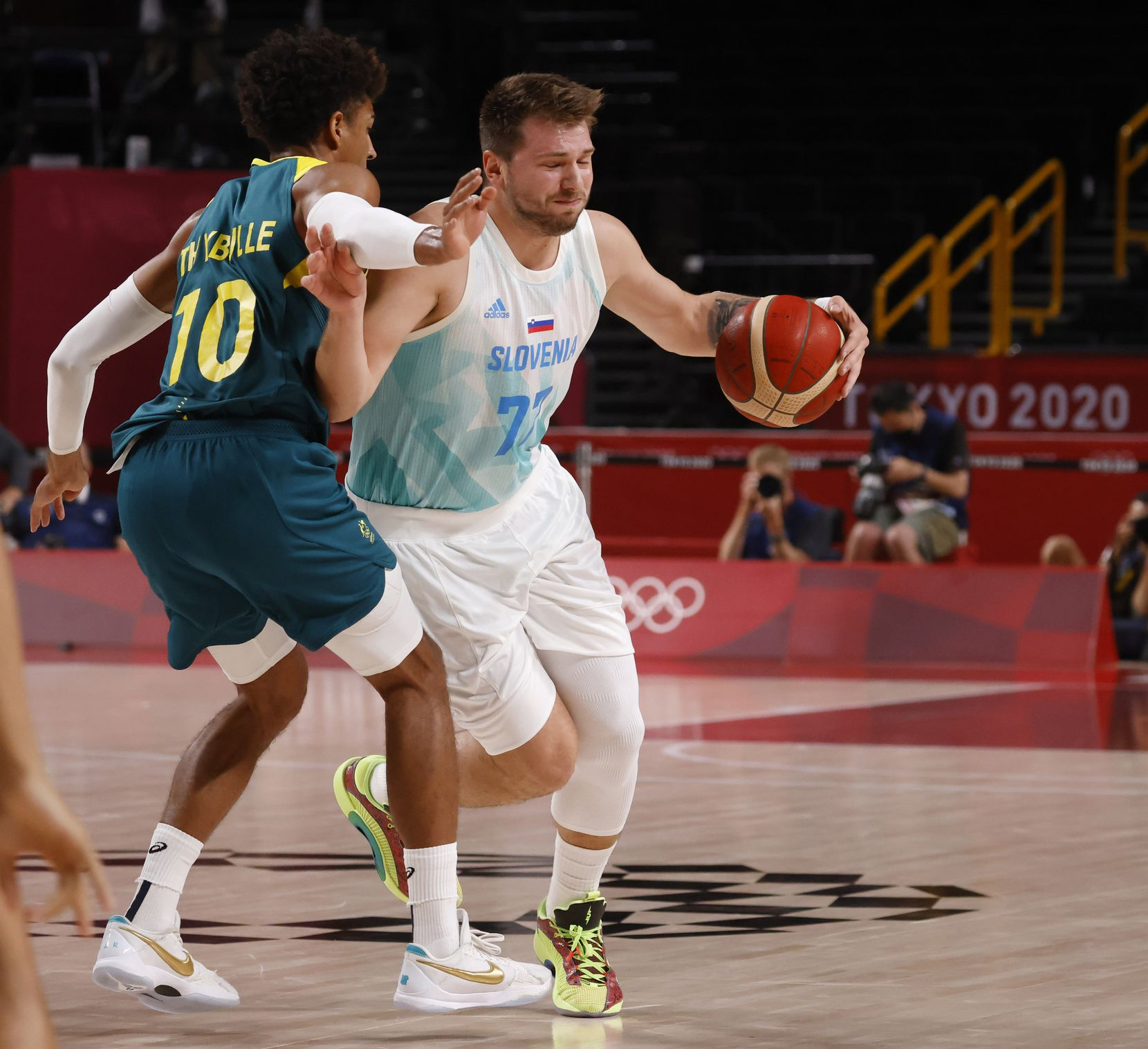 Slovenia's Luka Doncic (77) drives on Australia's Matisse Thybulle (10) during the first quarter of play in the bronze medal basketball game at the postponed 2020 Tokyo Olympics at Saitama Super Arena, on Saturday, August 7, 2021, in Saitama, Japan. (Vernon Bryant/The Dallas Morning News)