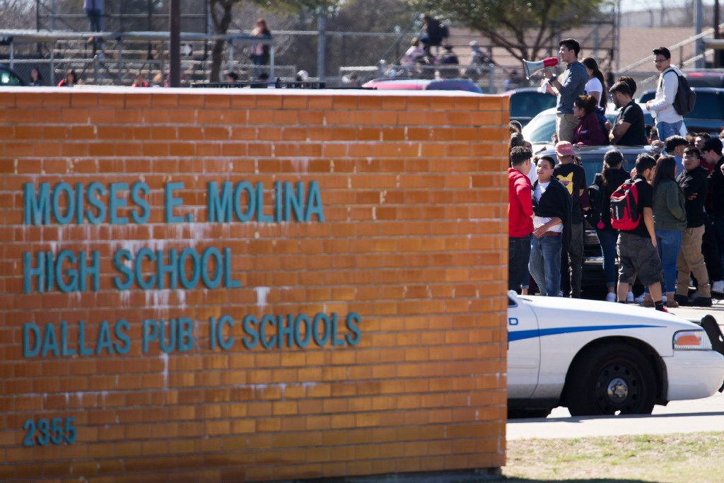"Students at Moises E. Molina High School walk out of class and rally in the parking lot in support of ""A Day Without Immigrants"" on Thursday, Feb. 16, 2017, in Dallas. (Smiley N. Pool/The Dallas Morning News)"