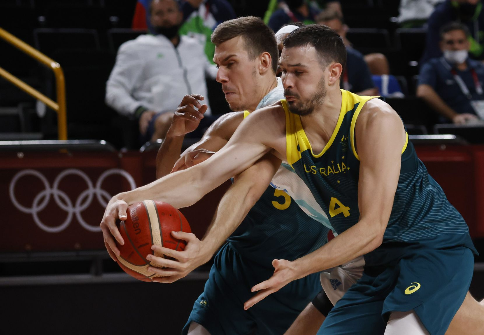 Slovenia's Vlatko Cancar (31) and Australia's Chris Goulding (4) fight for a loose ball during the second quarter of play in the bronze medal basketball game at the postponed 2020 Tokyo Olympics at Saitama Super Arena, on Saturday, August 7, 2021, in Saitama, Japan. (Vernon Bryant/The Dallas Morning News)