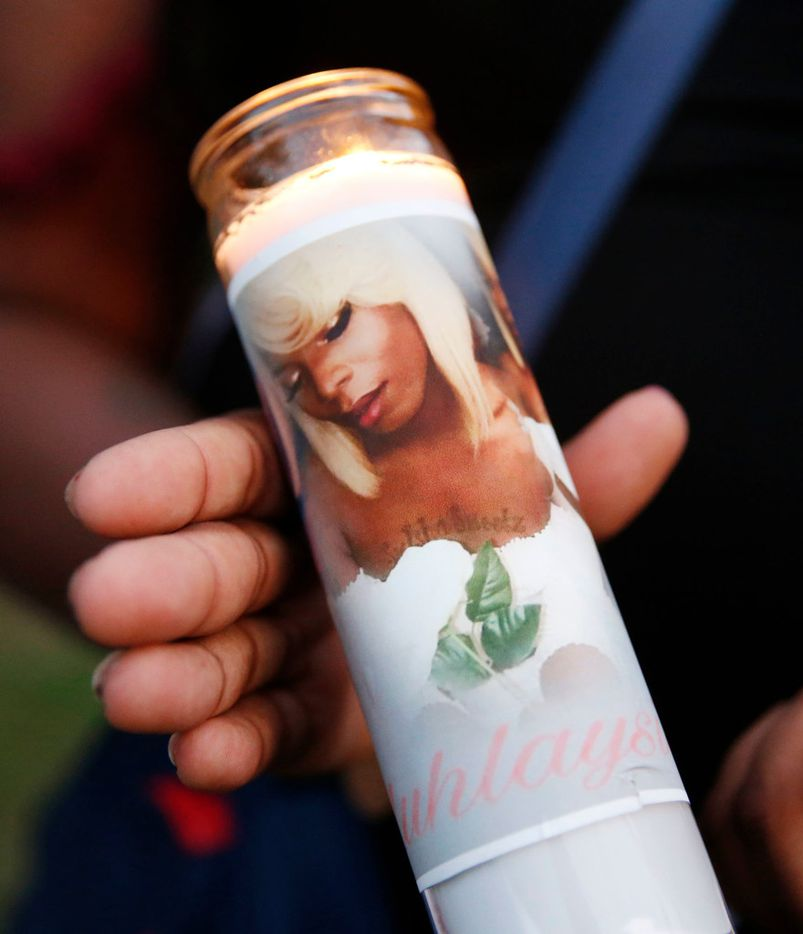 Muhlaysia Booker's image was wrapped around candles at the vigil.