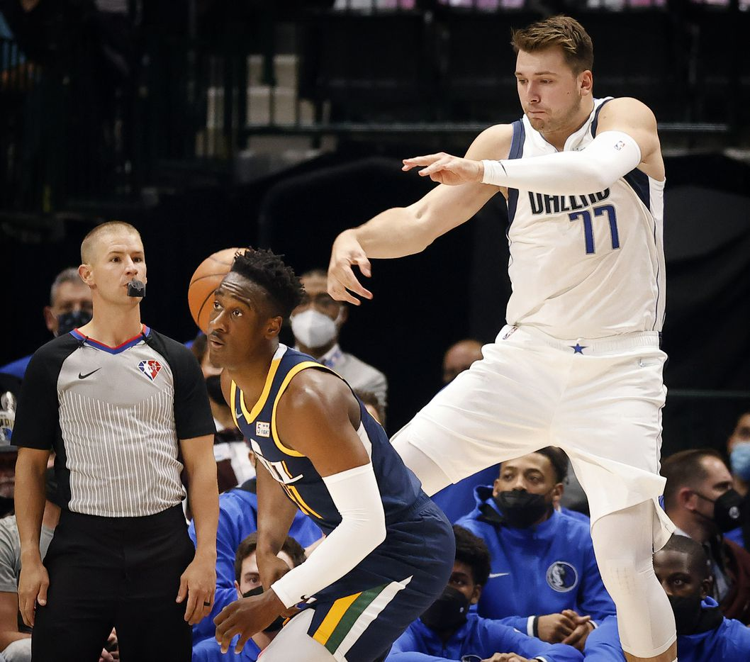 Dallas Mavericks guard Luka Doncic (77) throws the ball at Utah Jazz guard Miye Oni (81) as he tries to keep the ball in play during the first half at the American Airlines Center in Dallas, Wednesday, October 6, 2021.(Tom Fox/The Dallas Morning News)