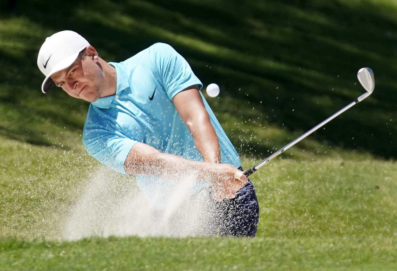 PGA Tour golfer Cameron Champ hits out of the No. 18 green side bunker during the opening round of the Charles Schwab Challenge at the Colonial Country Club in Fort Worth, Thursday, June 11, 2020.  The Challenge is the first tour event since the COVID-19 pandemic began. (Tom Fox/The Dallas Morning News)