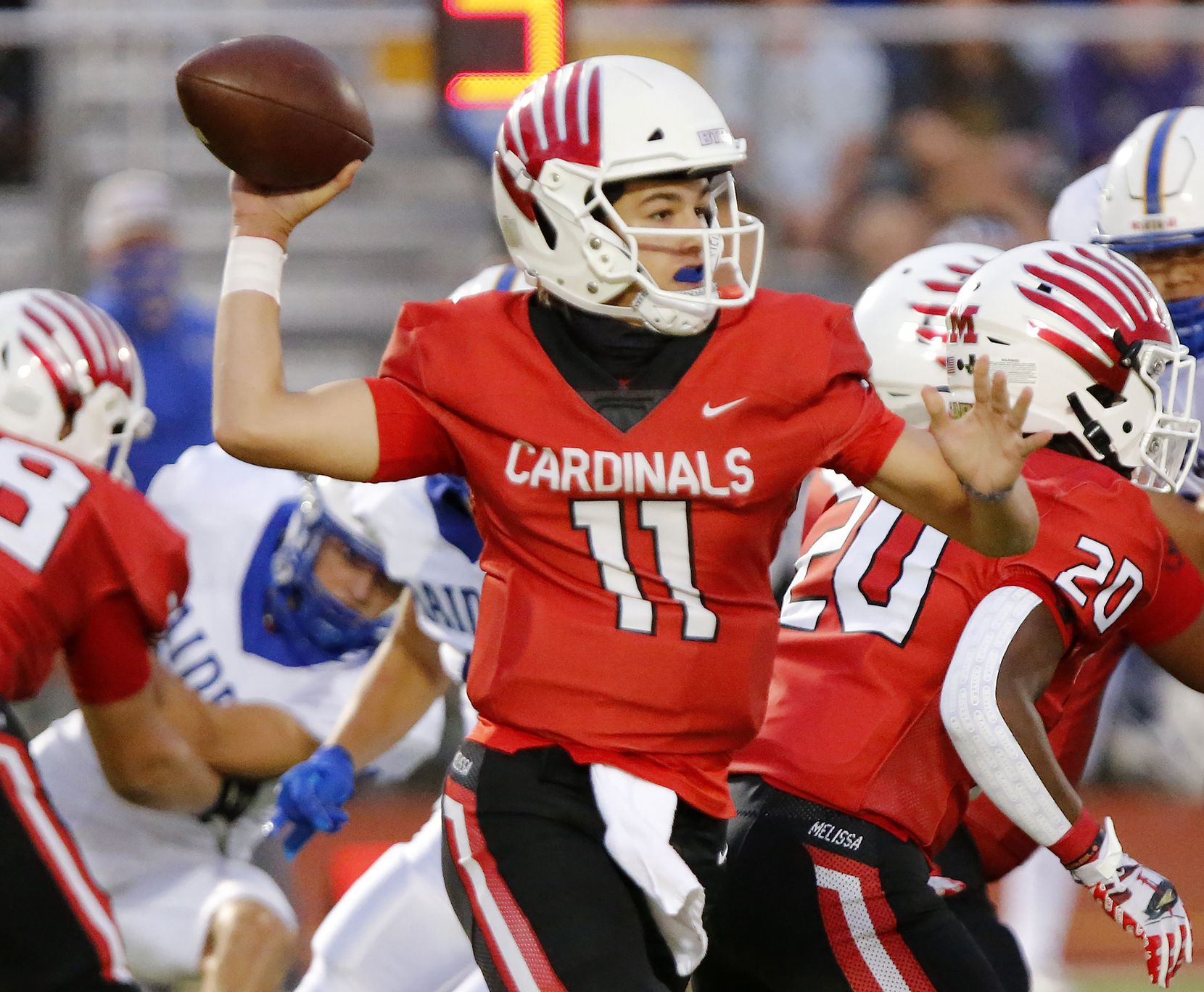 Melissa High School quarterback Sam Fennegan (11) throws a pass during the first half as Melissa High School hosted Sunnyvale High School at Melissa I.S.D. Stadium on Friday night, September 4, 2020.  (Stewart F. House/Special Contributor)