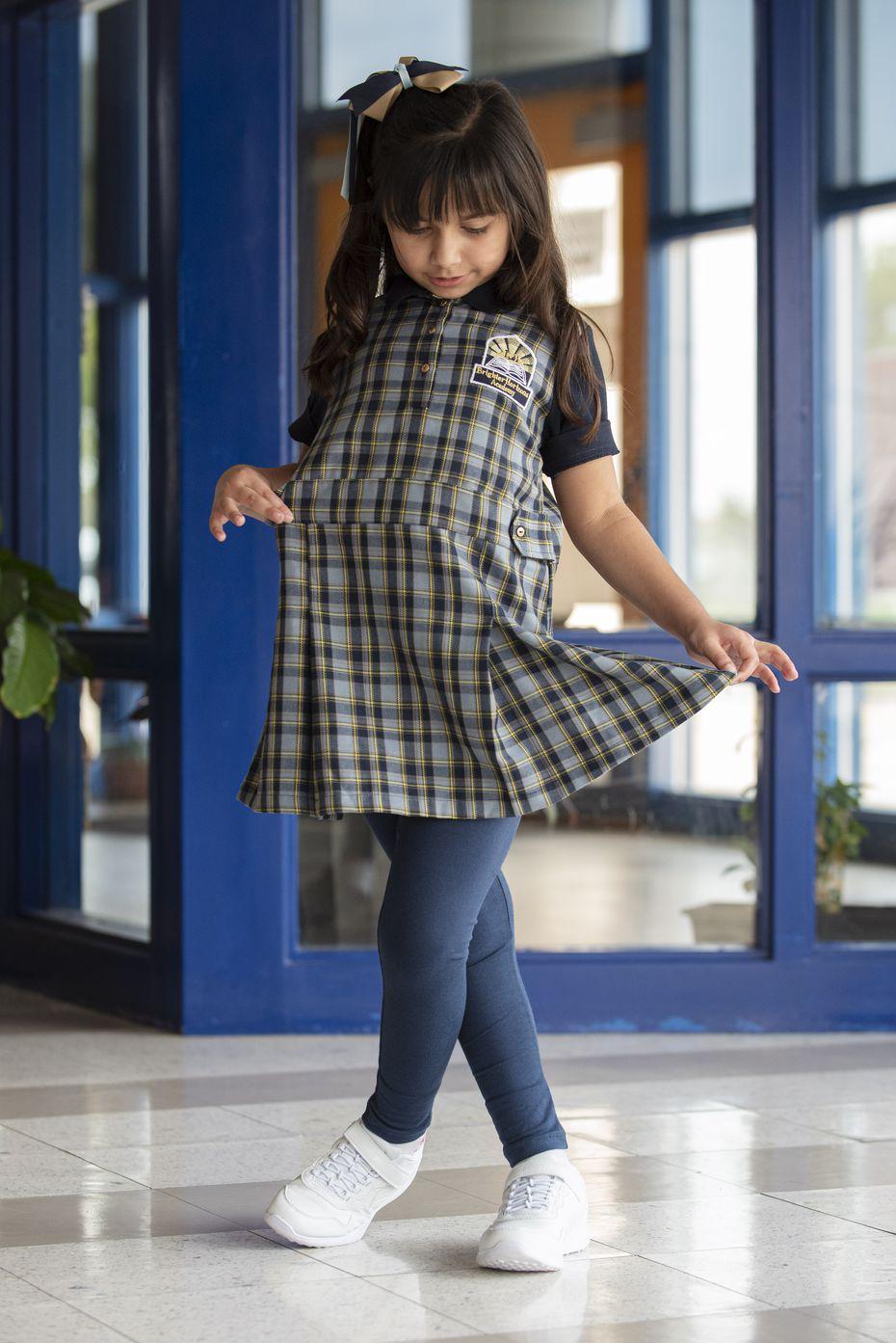 First-grader Sarah Kadiwala shows off her new school uniform at Brighter Horizons Academy in Garland.