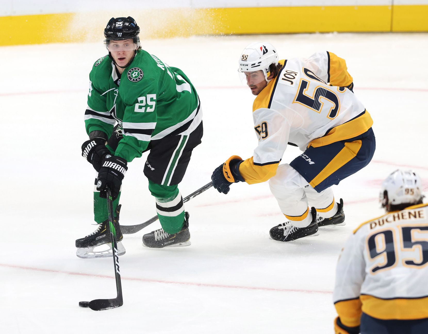 Dallas Stars left wing Joel Kiviranta (25) looks to pass as Nashville Predators defenseman Roman Josi (59) closes in on him during the first period of play in the Stars home opener at American Airlines Center on Friday, January 22, 2021in Dallas. (Vernon Bryant/The Dallas Morning News)