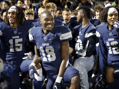Frisco Lone Star wide receiver Marvin Mims (18) is all smiles following his record breaking performance against Lancaster in their Class 5A Division I Regional championship at Wilkerson-Sanders Stadium in Rockwall, Texas, Friday, December 6, 2019. (Tom Fox/The Dallas Morning News)