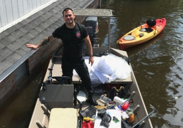 Kyle Parry retrieved his fiancee's wedding dress from his flooded house in Lumberton on Thursday, Aug. 31, 2017. (Provided by Kyle Parry)