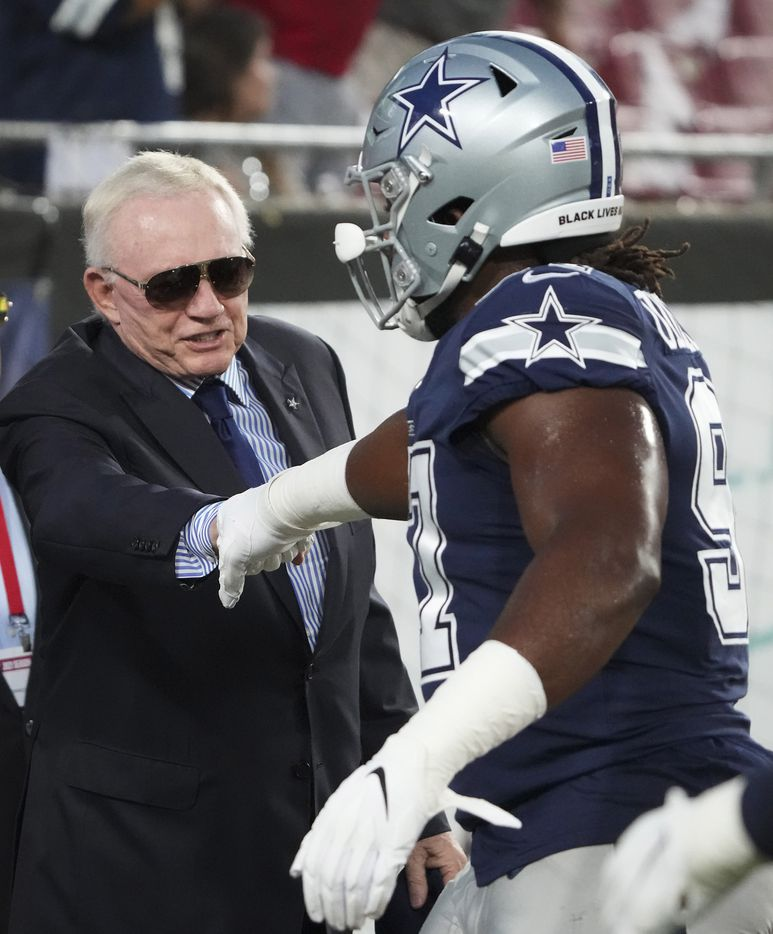 Dallas Cowboys owner and general manager Jerry Jones fist bumps defensive tackle Osa Odighizuwa before an NFL football game against the Tampa Bay Buccaneers at Raymond James Stadium on Thursday, Sept. 9, 2021, in Tampa, Fla. (Smiley N. Pool/The Dallas Morning News)