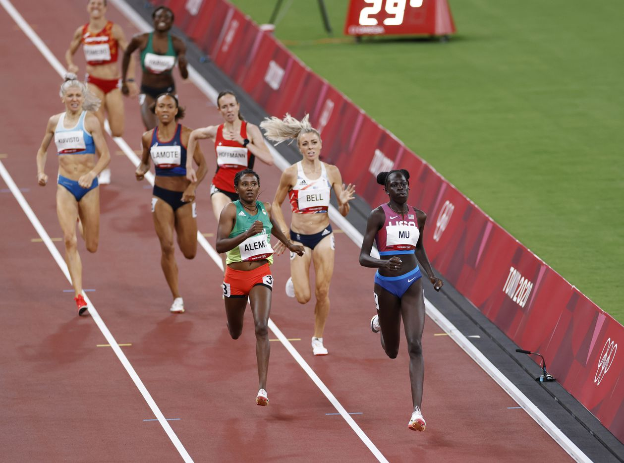 USA's Athing Mu leads the way in front of Ethiopia's Habitam Alemu as she competes in the women's 800 meter semifinal race during the postponed 2020 Tokyo Olympics at Olympic Stadium, on Saturday, July 31, 2021, in Tokyo, Japan. Mu finished with a time of 1:58.07 to advance to the next round. (Vernon Bryant/The Dallas Morning News)
