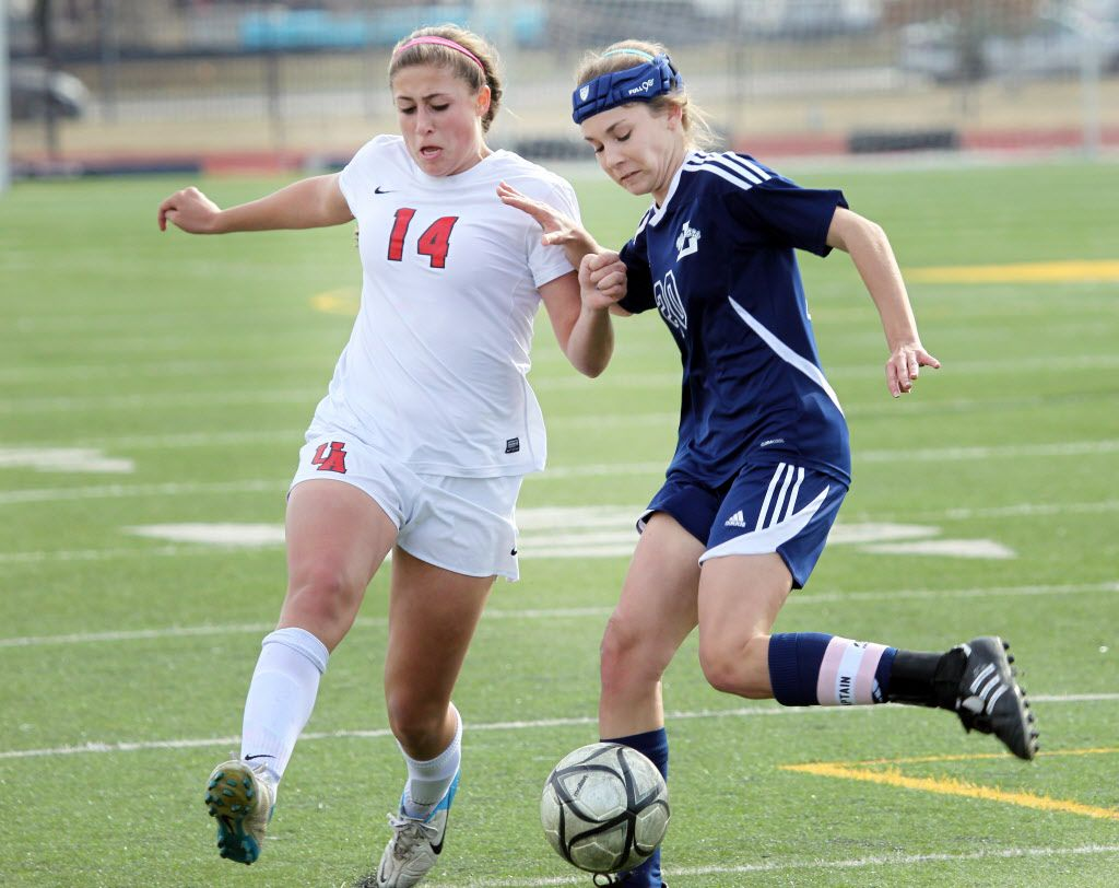 Ursuline's Alex Arenas and Argyle Liberty Christian #20 Brooke Stoermer battle each other over the ball during a girls soccer playoff game at John Paul II High School in Plano, TX on March 4, 2014.  (Kye R. Lee/The Dallas Morning News)