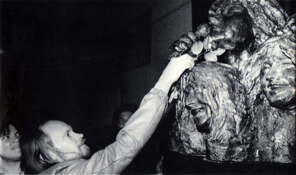 January 19, 1988: Bruce Reed places a rose on the sculpture of Janis Joplin which was unveiled tonight in Port Arthur, Texas.  The sculpture, by Doug Clark, will be the focal point of exhibits acknolwedging the musical heritage of Southeast Texas.  Today would have been Joplin's 45th birthday.