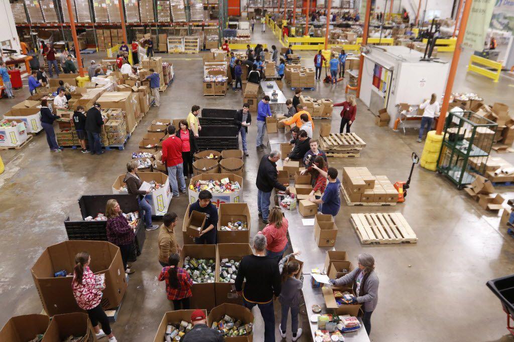 Volunteers help sort food at The North Texas Food Bank.  (File Photo)