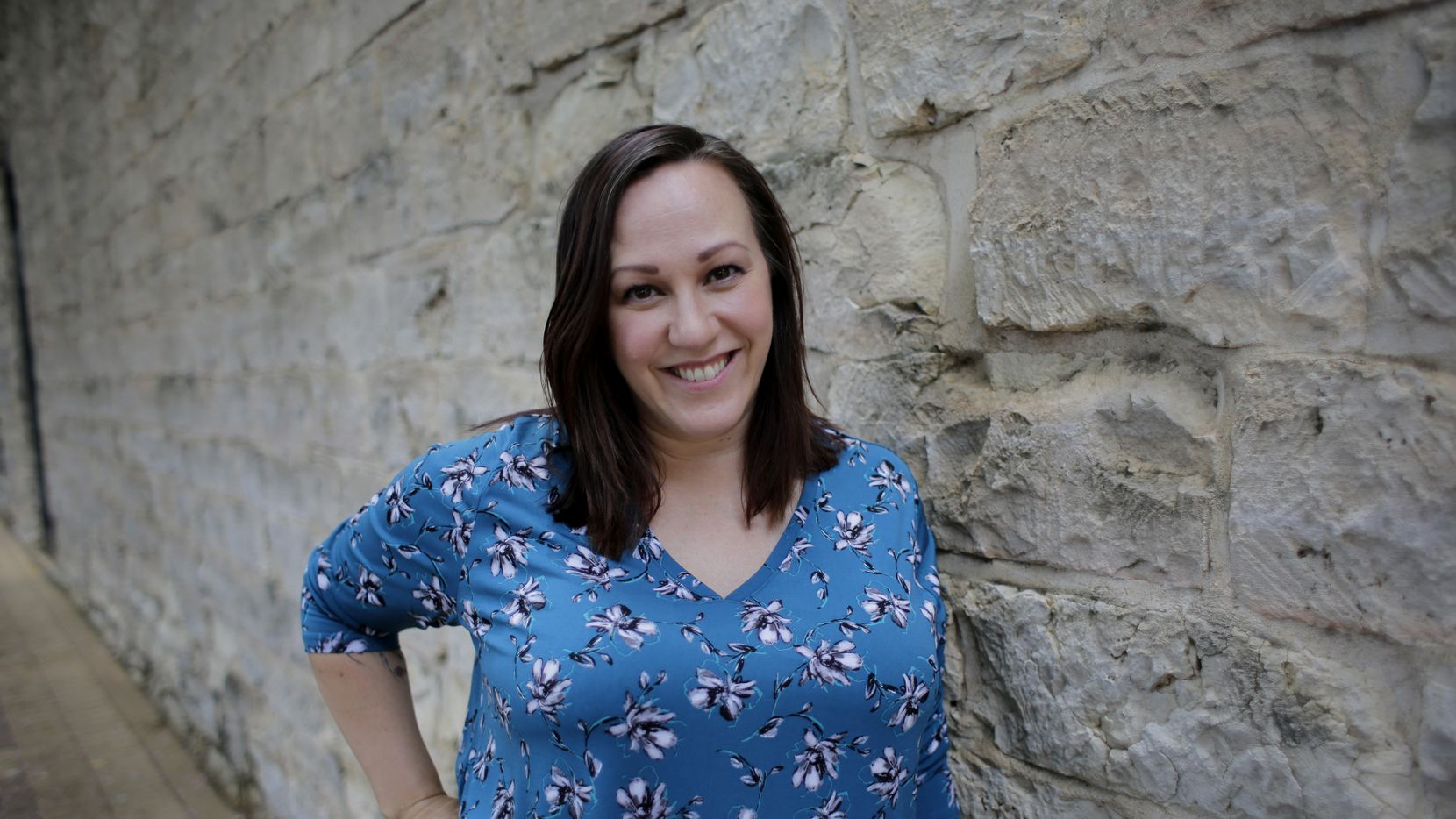 """MJ Hegar, shown in a July 2019 file photo in Round Rock, where she lives, is denying insinuations by Royce West, her opponent in the Democratic runoff for U.S. Senate, that she's not a real Democrat and may even have had tea party sympathies. On Tuesday, Hegar hit back at West, suggesting he's sexist and cozy with """"corruption."""""""