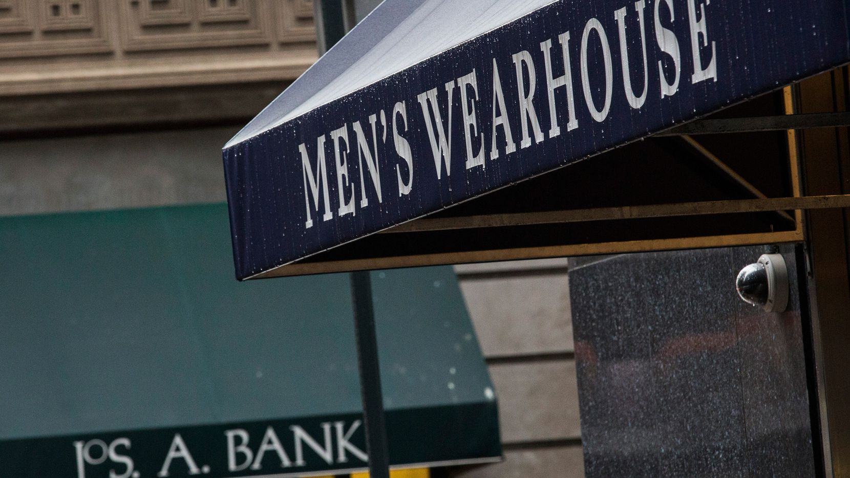 Men's Warehouse and Jos. A Bank storefronts.