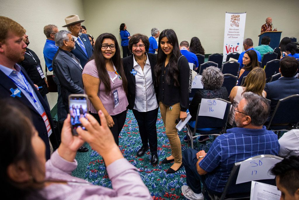 Gubernatorial candidate Lupe Valdez, center, poses for photos with delegates during the Texas Democratic Convention on Friday, June 22, 2018 at the Fort Worth Convention Center in Fort Worth.
