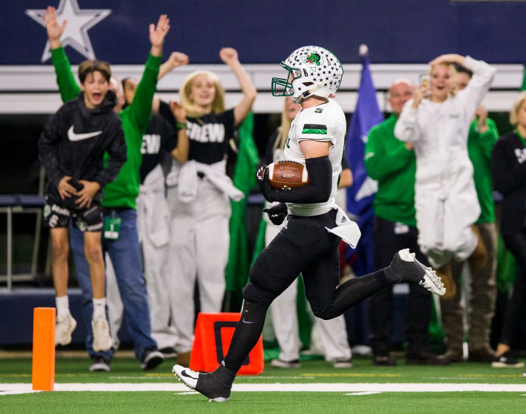 Southlake Carroll wide receiver Owen Allen (4) runs to the end zone for a touchdown during the first quarter of a Class 6A Division I area-round high school football playoff game between Southlake Carroll and DeSoto on Friday, November 22, 2019 at AT&T Stadium in Arlington. (Ashley Landis/The Dallas Morning News)