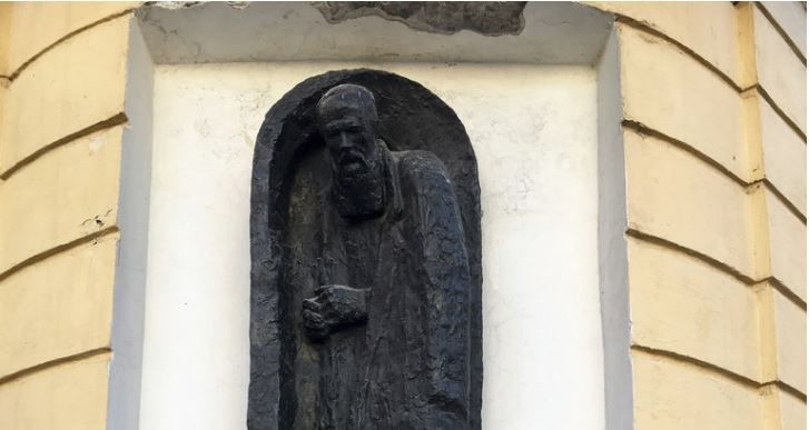 "Monument to the house of Raskolnikov, the main character in Dostoevsky's ""Crime and Punishment,"" a fictional character who lived in the very real top floor corner apartment at Grazhdanskay Ulitsa and Stolyarnyy Pereulok."