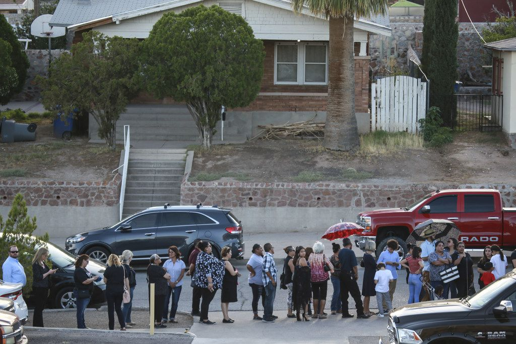 Well-wishers stand in line to pay tribute during a public memorial for Margie Reckard, one of 22 killed during the Walmart shooting in El Paso.