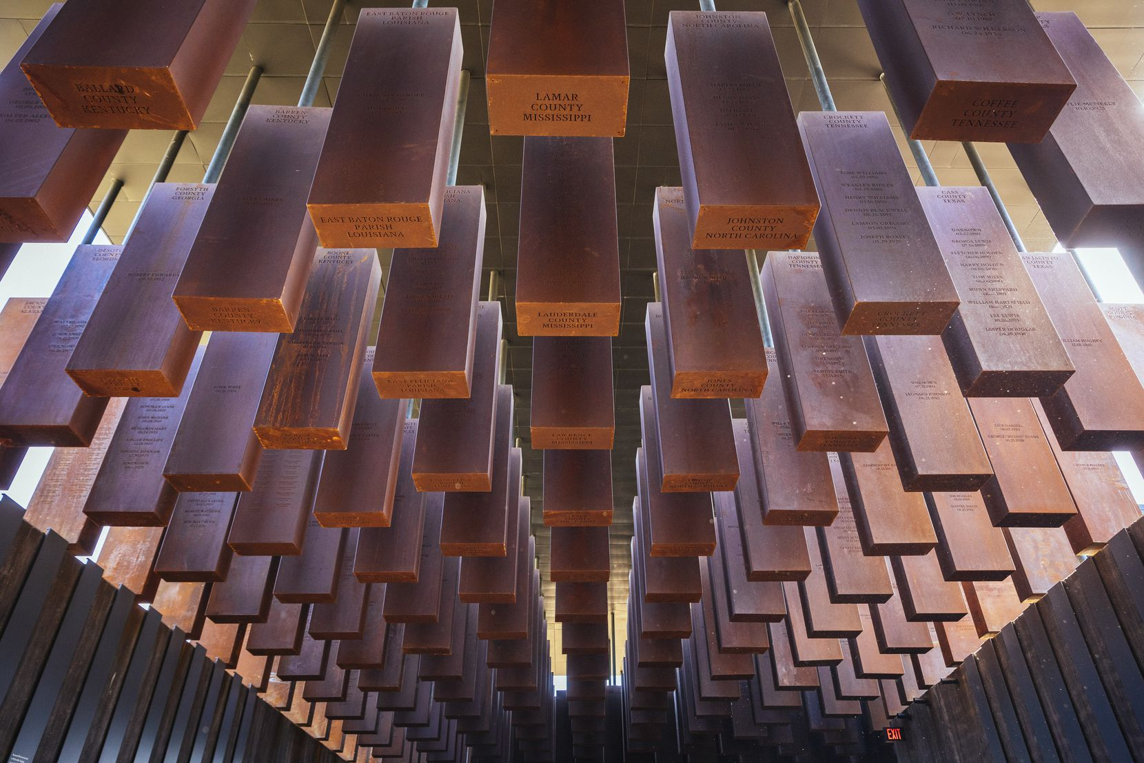 Eight hundred weathered steel columns, each one etched with the names of lynching victims, hang from the roof of the National Memorial for Peace and Justice in Montgomery, Ala.