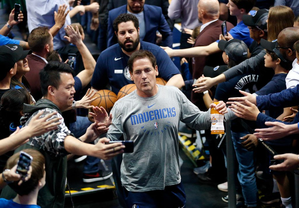 Dallas Mavericks owner Mark Cuban slaps hands with fans as he leaves the court following their game against the Memphis Grizzlies at the American Airlines Center in Dallas, Friday, April 5, 2019. The Mavericks lost, 122-112.(Tom Fox/The Dallas Morning News)