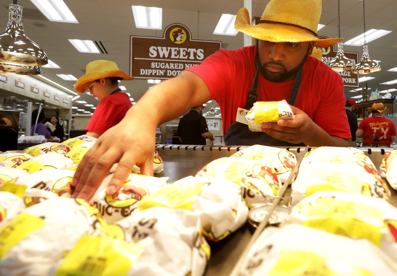 Eric Thomas stocks the Bacon Egg & Cheese Croissants at the new Buc-ee's in Melissa, TX, on Apr. 29, 2019.