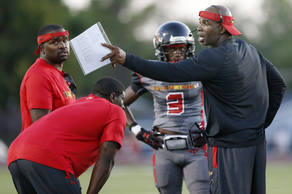 AAA Prime U coach Deion Sanders speaks to his players during a high school football game between AAA Prime U and Fort Worth Christian at Fort Worth Christian in North Richland Hills, Texas Friday September 4, 2015. (Andy Jacobsohn/The Dallas Morning News)
