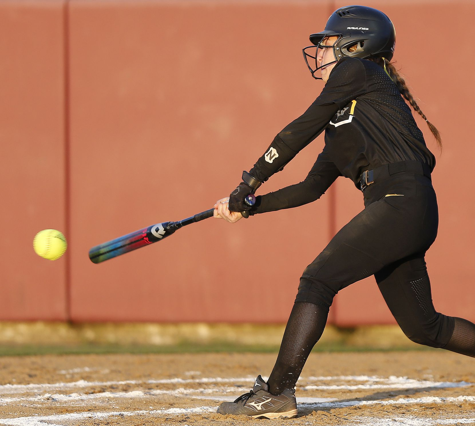 Memorial second baseman Ashley Camacho (2) gets a hit in the second inning as Heritage High School hosted Memorial High School for the District 9-5A softball championship in Frisco on Tuesday, April 20, 2021. (Stewart F. House/Special Contributor)