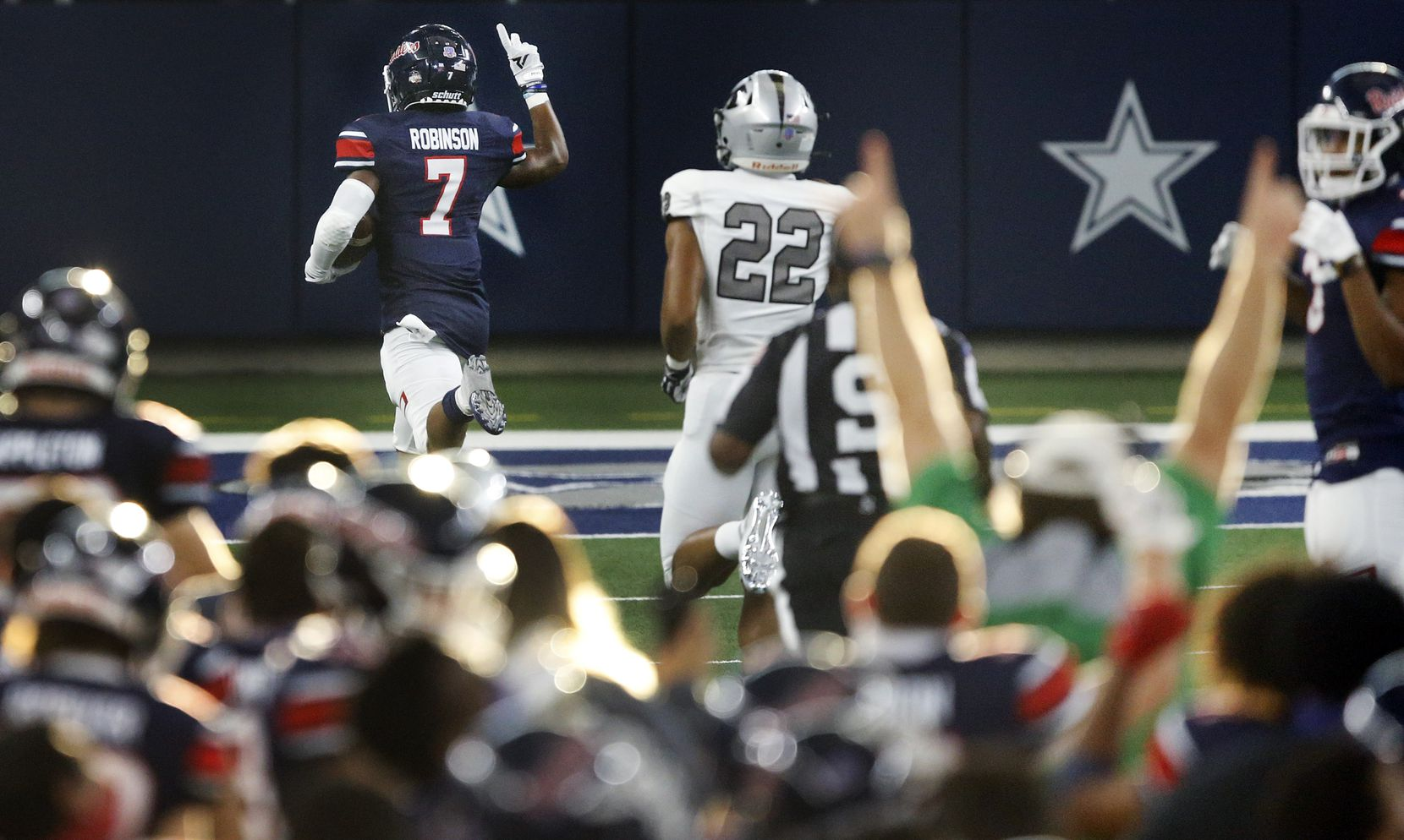 Denton Ryan cornerback Garyreon Robinson (7) races for a fourth quarter touchdown after picking up an Arlington Martin fumble at AT&T Stadium in Arlington, Friday, September 25, 2020. (Tom Fox/The Dallas Morning News)