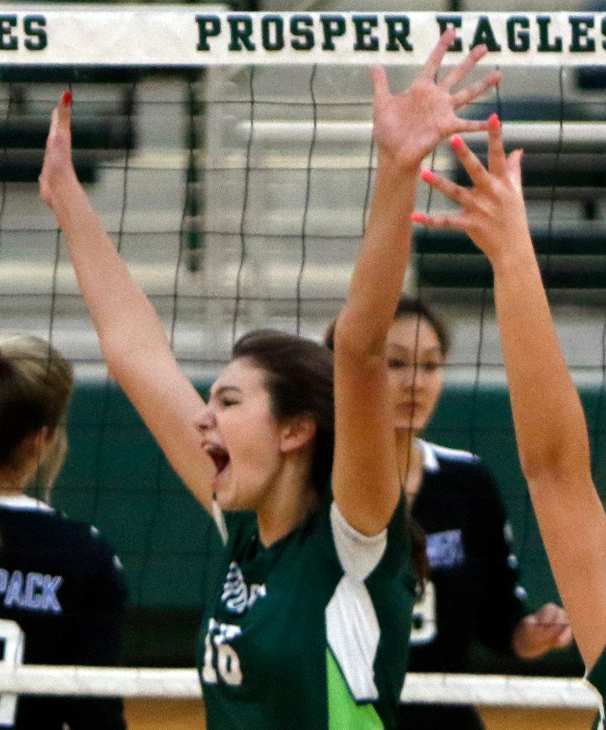 Prosper's Taylor Youtsey (16) exults after blocking the shot of a Plano West player during the first game of their match. The two teams played their District 9-6A volleyball match at Prosper High School in Prosper on October 22, 2019. (Steve Hamm/ Special Contributor)