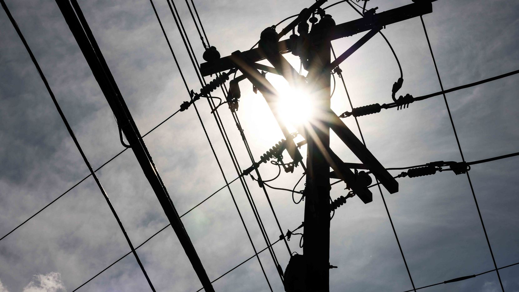 The temperature reached 97 degrees and felt like 105 in Dallas on June 14, 2021, as ERCOT send a conservation alert asking Texans to reduce electric use through Friday.