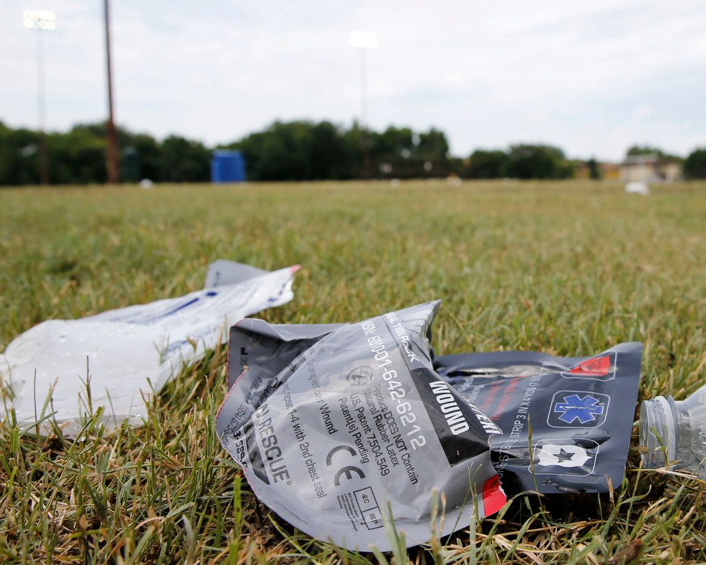 Medical supplies and debris on the football field at the Juanita Craft Recreation Center in Dallas.