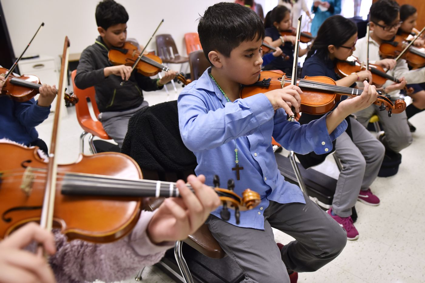 "Melvin Carrera, center, plays his violin during ""Technique Boot Camp"" Wednesday."