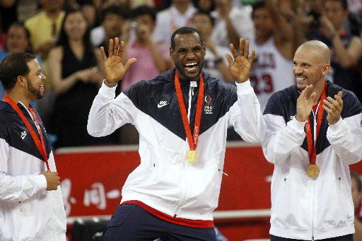 ORG XMIT: *S0424076052* Alongside teammates Deron Williams (left) and Jason Kidd of the Dallas Mavericks (right), USA men's basketball player LeBron James (center) does a dance after receiving his gold medal, Sunday, August 24, 2008 at the Wukesong Indoor Basketball Stadium. USA beat Spain 118-107