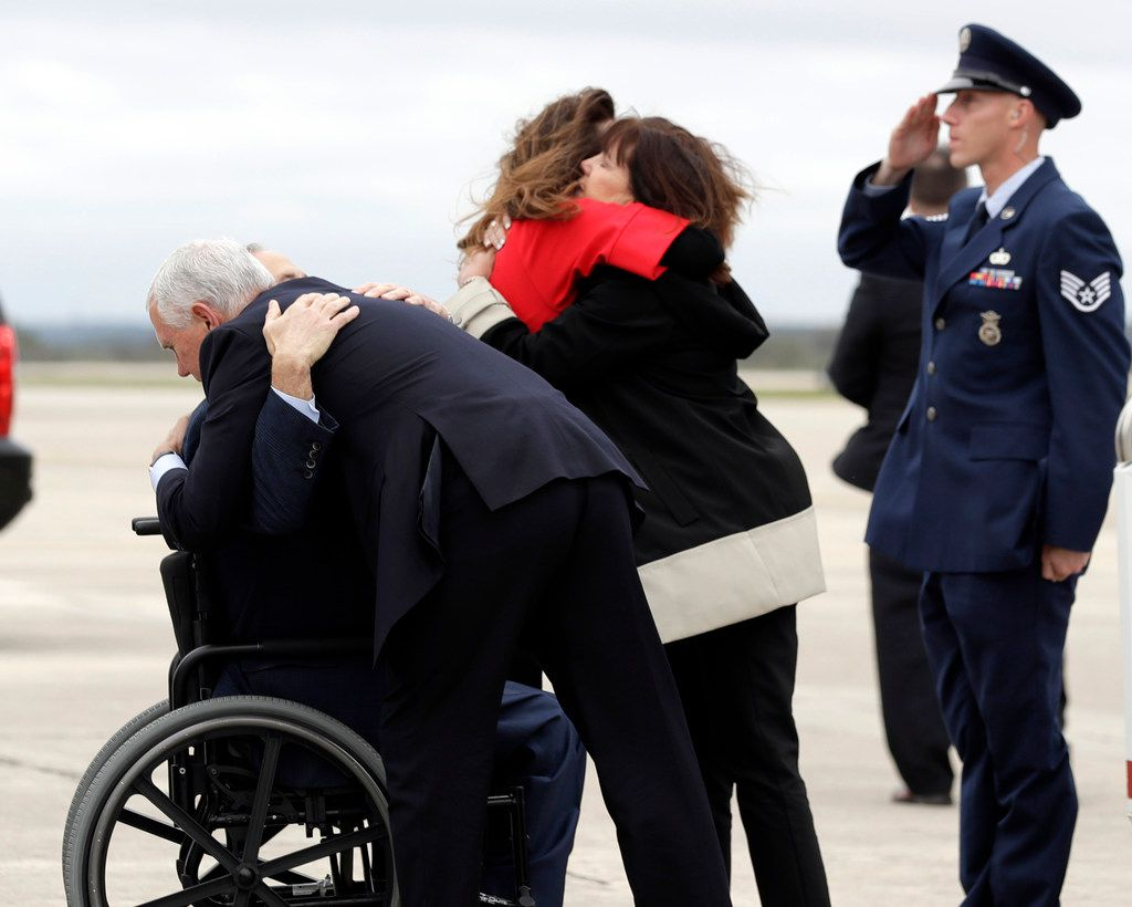 Vice President Mike Pence hugs Texas Gov. Greg Abbott as wife Karen Pence (right) shares an embrace with Abbott's wife, Cecilia, after the Pences' arrival in San Antonio last year. Pence traveled to Texas to visit victims of the Sutherland Springs First Baptist Church shooting at a local hospital, as well as visit with the families of the victims and participate in a prayer vigil.