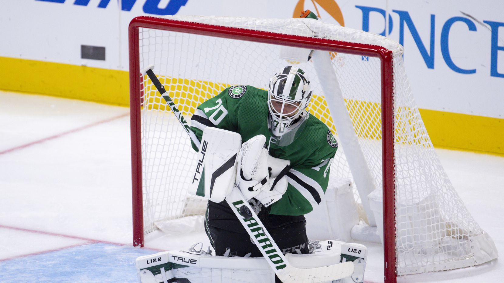 Dallas Stars goaltender Braden Holtby (70) stops a St. Louis Blues goal during the third period of a Dallas Stars preseason game against St. Louis Blues on Tuesday, Oct. 5, 2021, at American Airlines Center in Dallas.