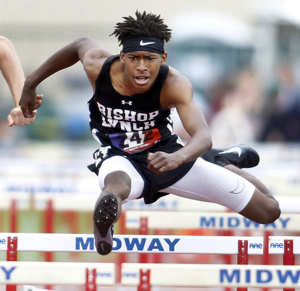 Dallas Bishop Lynch hurdler Jeremiah Williams clears a hurdle enroute to his first place finish in the Class 6A Men110 Meter Hurdles event with a time of 15.51. The running finals from the TAPPS state track meet were held at Waco Midway's Panther Stadium in Hewitt on May 1, 2021. (Steve Hamm/ Special Contributor)