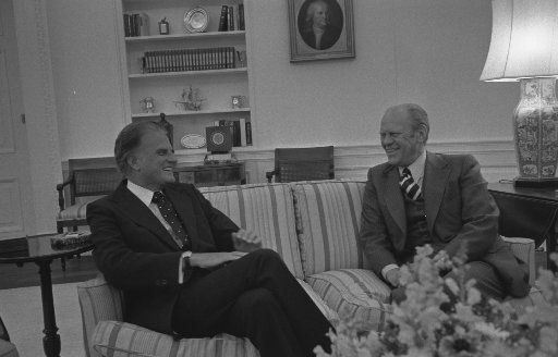 President Gerald R. Ford with Billy Graham in the White House Oval Office, Sept. 22, 1976.