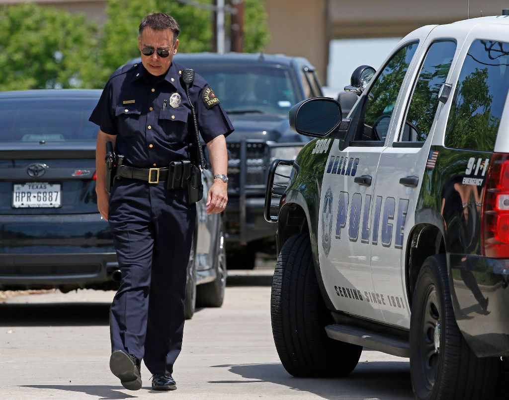A Dallas Police Department officer leaves a shooting scene where police found two people dead at an office building in Lake Highlands near the High Five in Dallas, Monday, April 24, 2017. (Jae S. Lee/The Dallas Morning News)