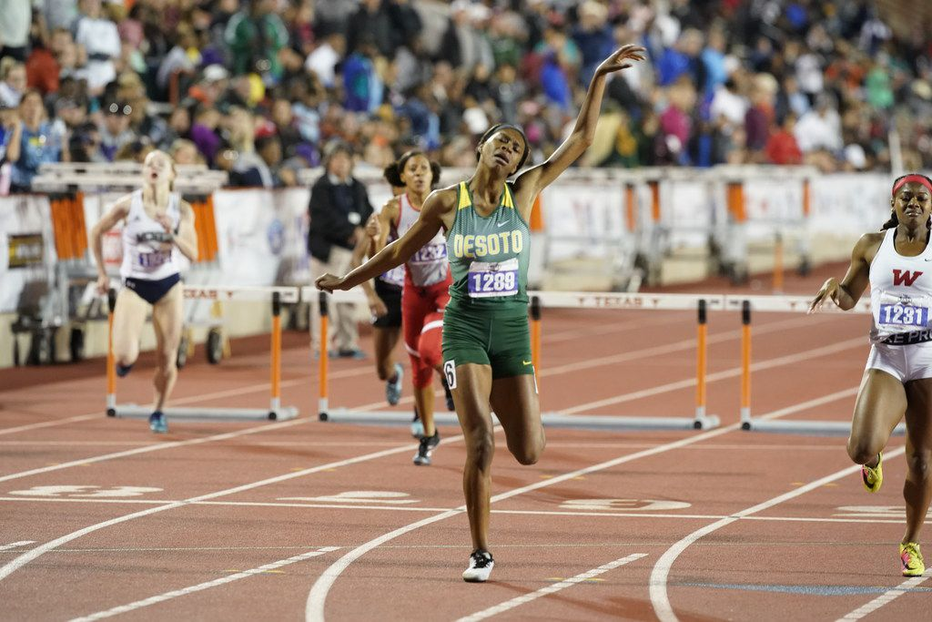 DeSoto's Taylor Armstrong (1289) flails her arms in victory at the finish line of the girls 300-meter hurdles class 6A at the UIL state track meet.   Armstrong won with a clocking of 42.19 seconds.  (Bob Daemmrich/Special Contributor)