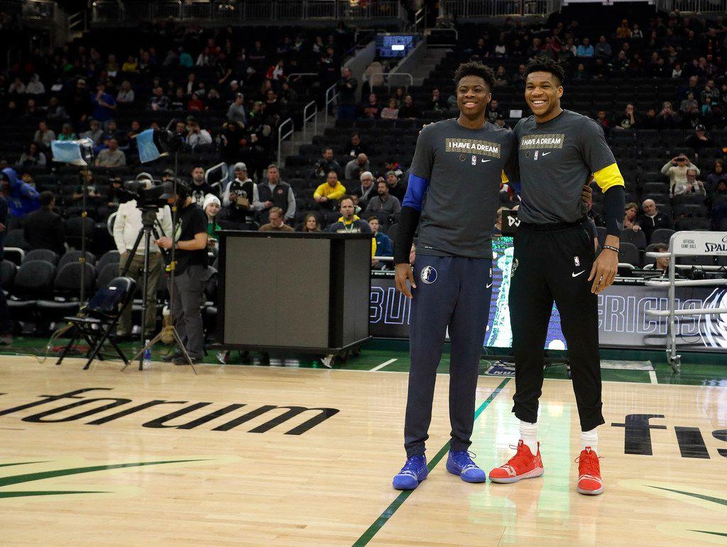 Milwaukee Bucks' Giannis Antetokounmpo, right, and Dallas Mavericks' Kostas Antetokounmpo, left, pose for a photo before an NBA basketball game Monday, Jan. 21, 2019, in Milwaukee. (AP Photo/Aaron Gash)