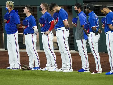 Texas Rangers players stand for the national anthem before exhibition game against the Colorado Rockies at Globe Life Field on Tuesday, July 21, 2020.