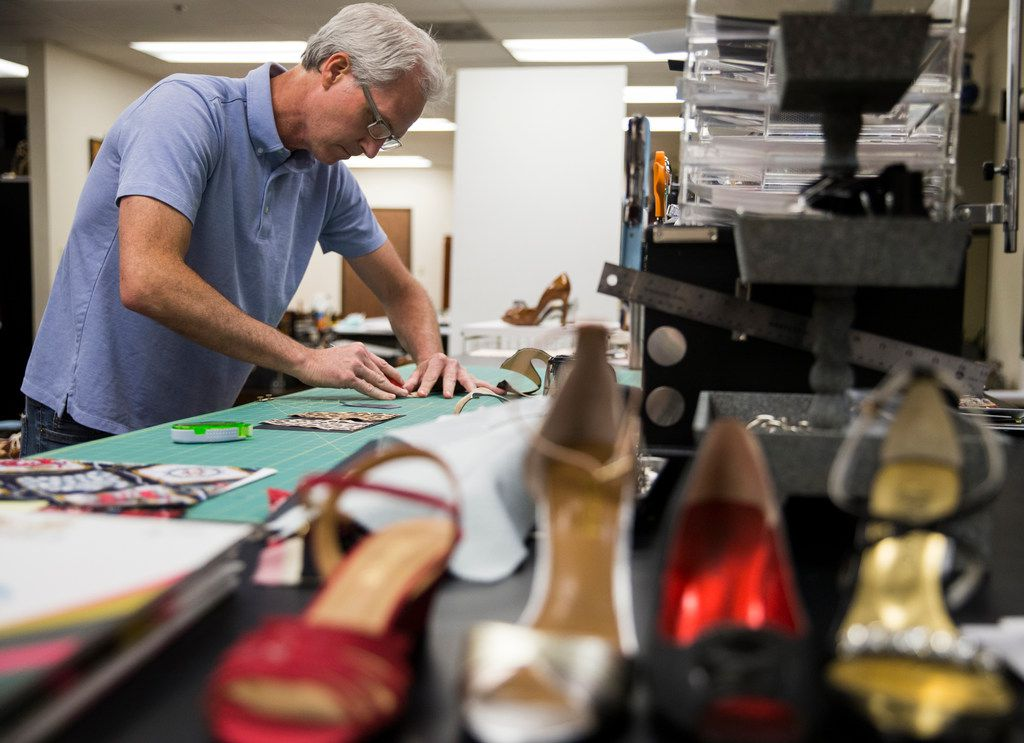 Kai Harrison works in the design room on Friday, June 14, 2019 of the Harrison family owned J. Renee shoe company in Carrollton.