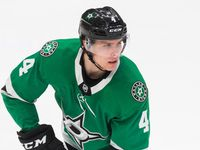 Dallas Stars defenseman Miro Heiskanen (4) looks for a pass during the second period of an NHL game between the Dallas Stars and the Carolina Hurricanes on Tuesday, February 11, 2020 at American Airlines Center in Dallas.