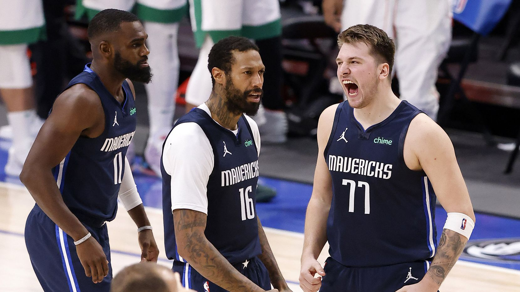 Dallas Mavericks guard Luka Doncic (77) celebrates his game-winning shot with forward James Johnson (16) in the fourth quarter against the Boston Celtics at the American Airlines Center in Dallas, Tuesday, February 23, 2021.