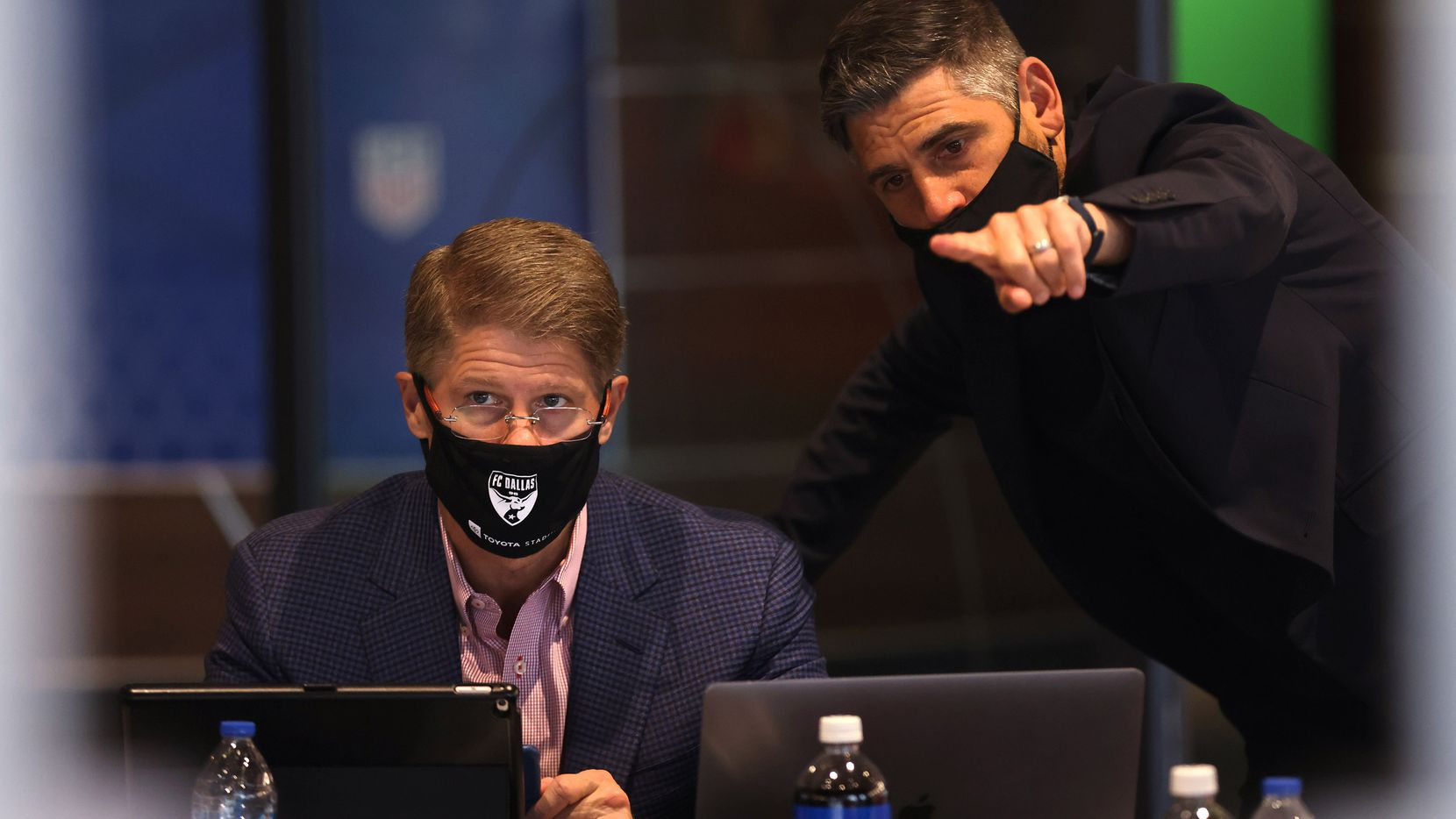 Luchi Gonzalez (right), FC Dallas head coach points towards the board of players as he talks to  Clark Hunt, FC Dallas president during round 1 of  the MLS SuperDraft at Toyota Stadium on Thursday, January 21, 2021in Frisco, Texas.