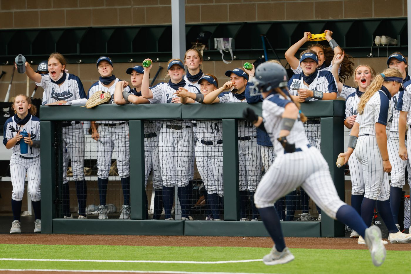 Flower Mound players cheer on teammate Katie Cantrell (20) during the fifth inning of a softball Class 6A bi-district playoff game against McKinney Boyd on Friday, April 30, 2021, in Denton. (Juan Figueroa/The Dallas Morning News)